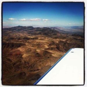 Travel_airplane_window_mountains.jpg