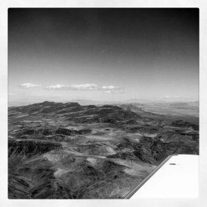 Travel_airplane_window_mountains_blackandwhite.jpg