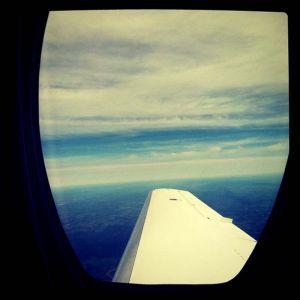 Travel_airplane_window_wing_clouds.jpg